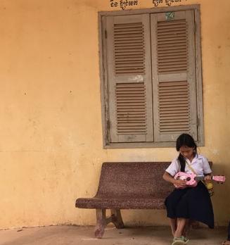 girl plays ukulele alone cropped.jpg
