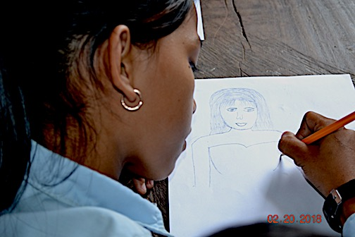 A girl draws an art lesson