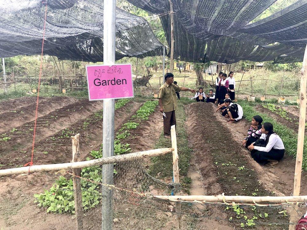 80 gardener teaching students.jpg