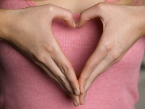Woman Forming Heart Shape with Hands