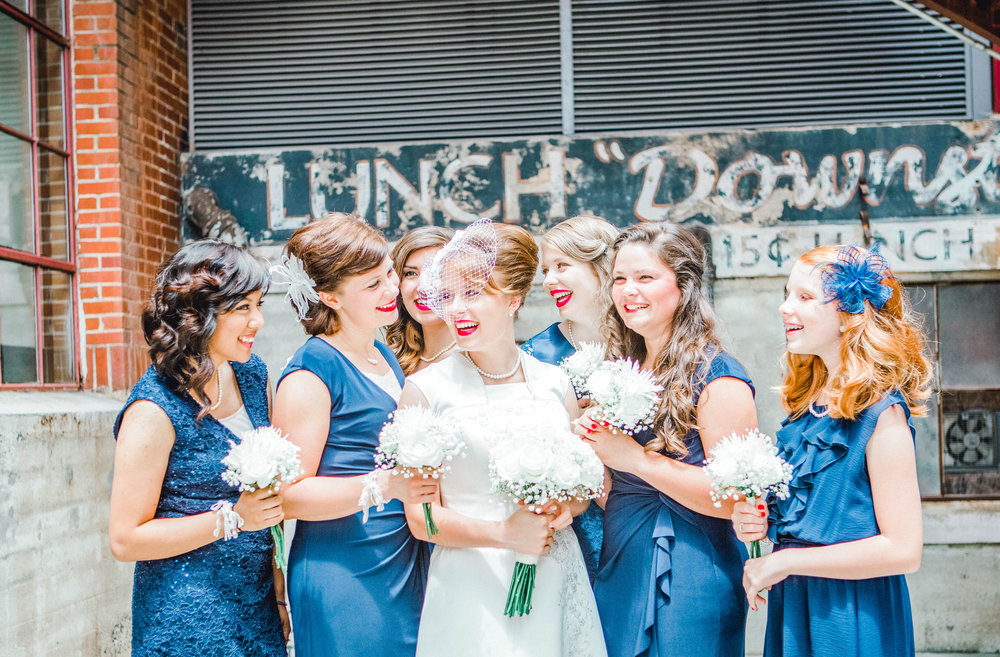 Brides and bridesmaids at the American Tobacco Campus in Durham, NC.