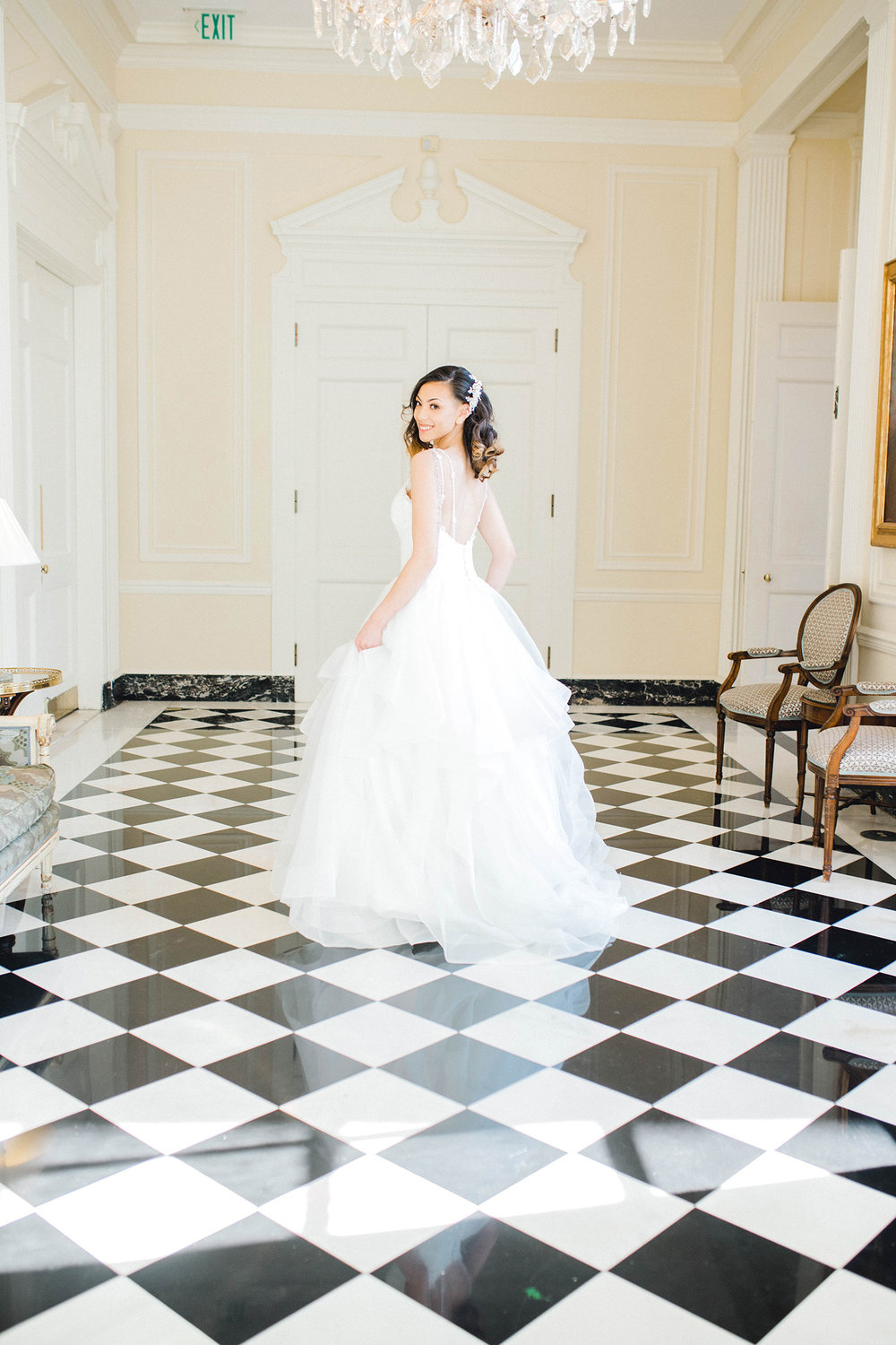 A bride on a checkerboard floor at the Duke Mansion in Charlotte, NC