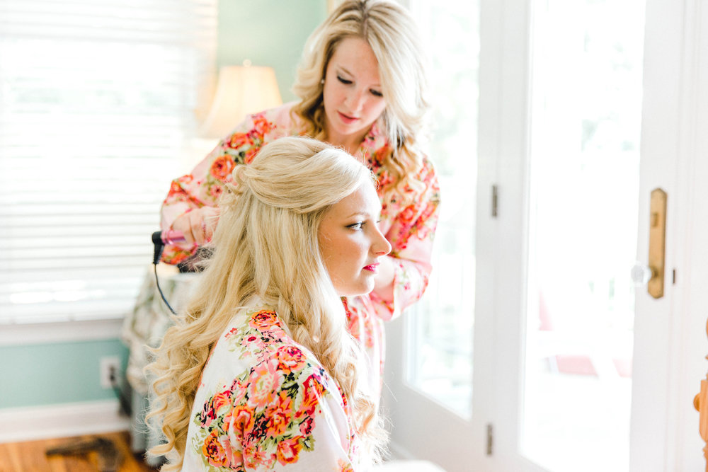 A bride getting her hair and makeup done for her Swansboro, NC Wedding.
