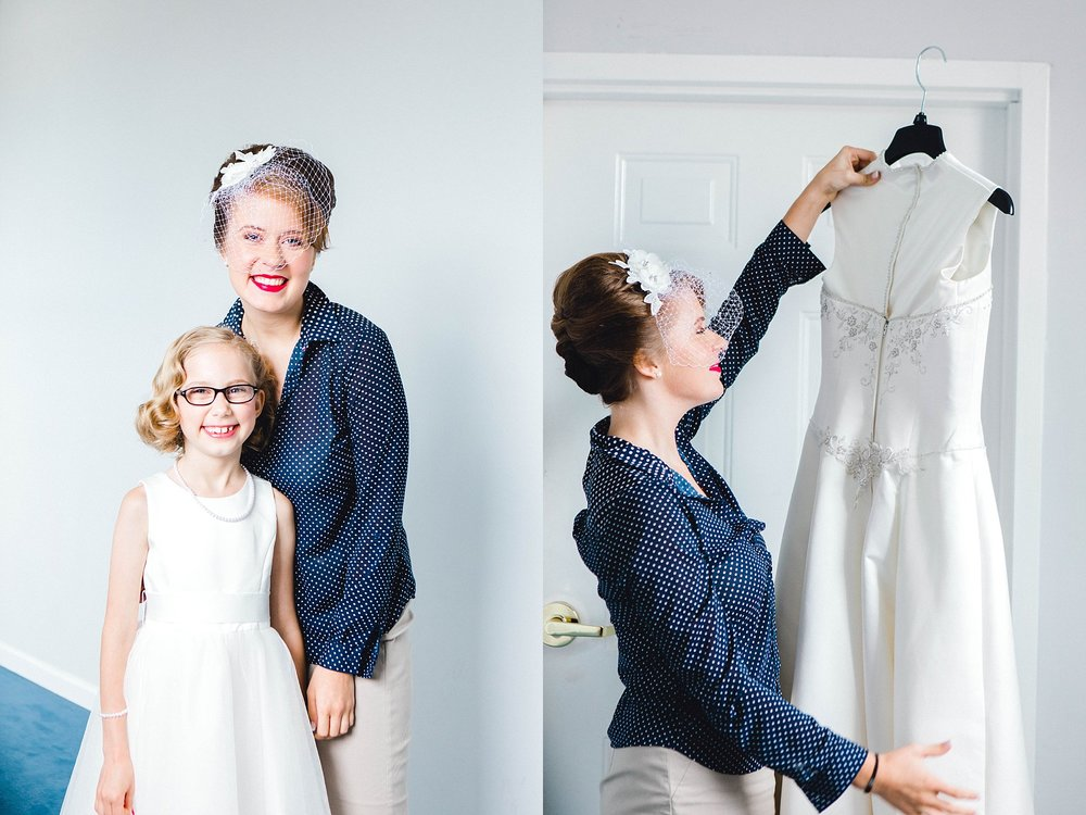 A bride posing and smiling with her flower girl.