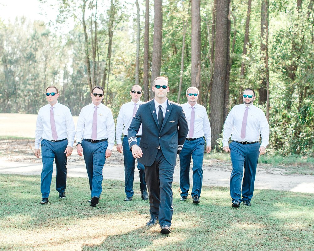 Groomsmen wearing Costa sunglasses.