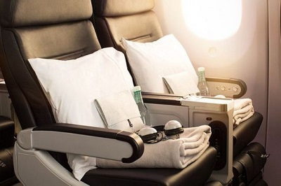 "Enjoy more legroom with the largest seat pitch in its class and relax with 50% more recline than Economy.  Air New Zealand has customised a beautifully comfortable ink coloured luxury leather seat with generous armrests, a leg rest and foot support. Seats have a 41"" pitch, 9"" recline and width of 19.3"" with a 5"" wide armrest."
