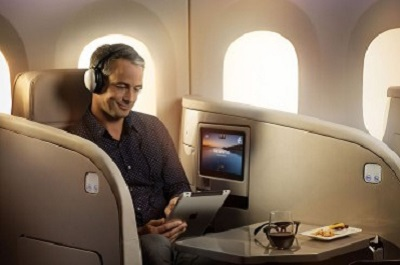 """Relax in comfort while you enjoy the special features of the Business Premier seat. The seat is a luxurious 22"""" wide leather armchair with separate ottoman footrest that doubles as a visitor's seat. When it's time to sleep, it converts to a 6'7.5"""" bed with your own large cotton pillow, duvet and sleep sheet."""