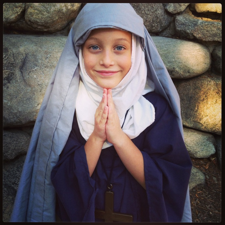 Mathilda dresses up as St. Rita on All Saint's day-- the patron saint of the impossible. Post- nap she was able to recite a few lines in front of her peers at school. I suspect she chose to be this saint for a reason.