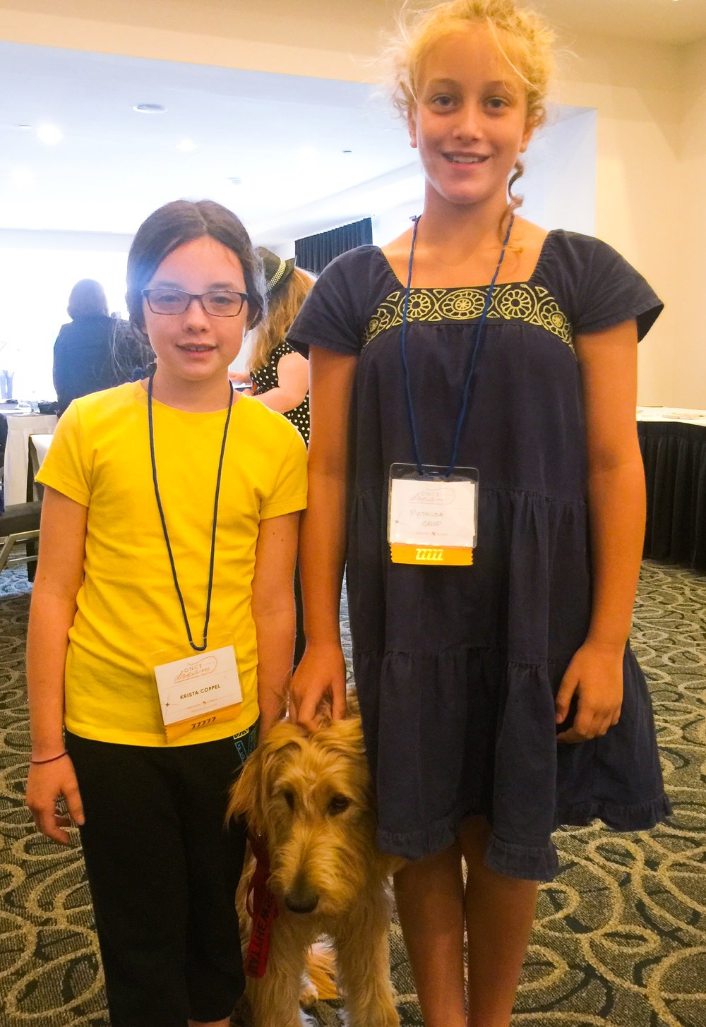 Mathilda with Krista and her service dog Buddy.