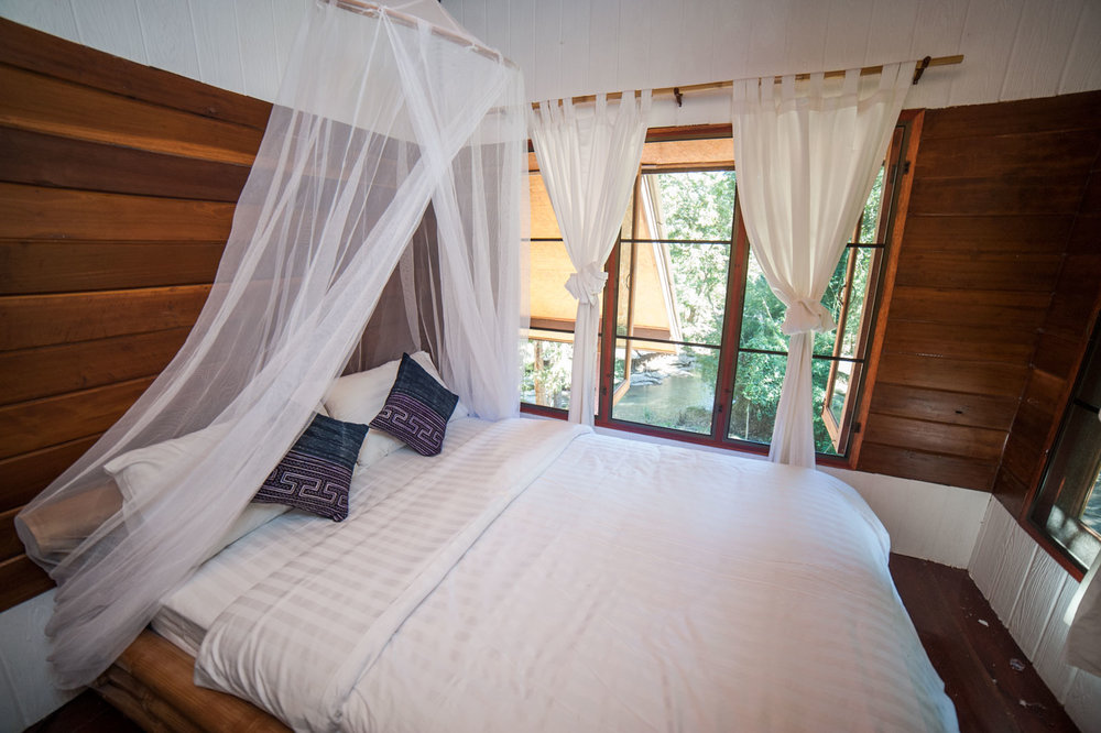 RIVERVIEW BUNGALOW 5 (A/C)   1-2 Guests   • Queen Bed • Mosquito net canopy • Ensuite bathroom • Outdoor seating area • Breakfast included • A/C