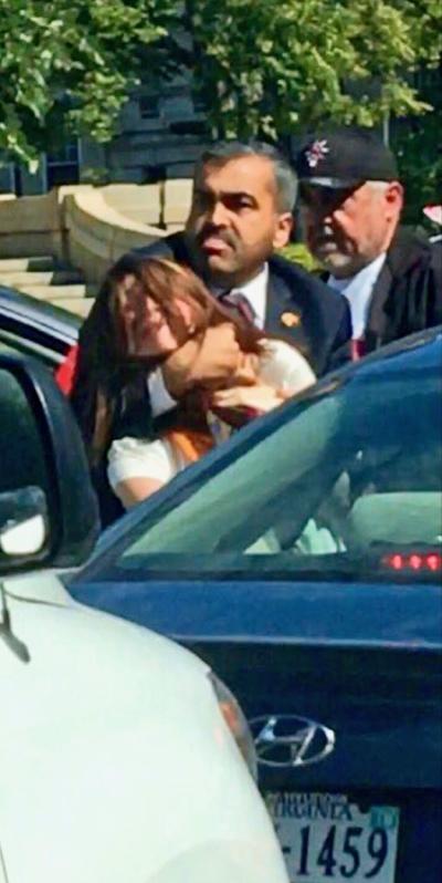 Turkish security choking Borazan. Photo courtesy of Baltimore Bloc.