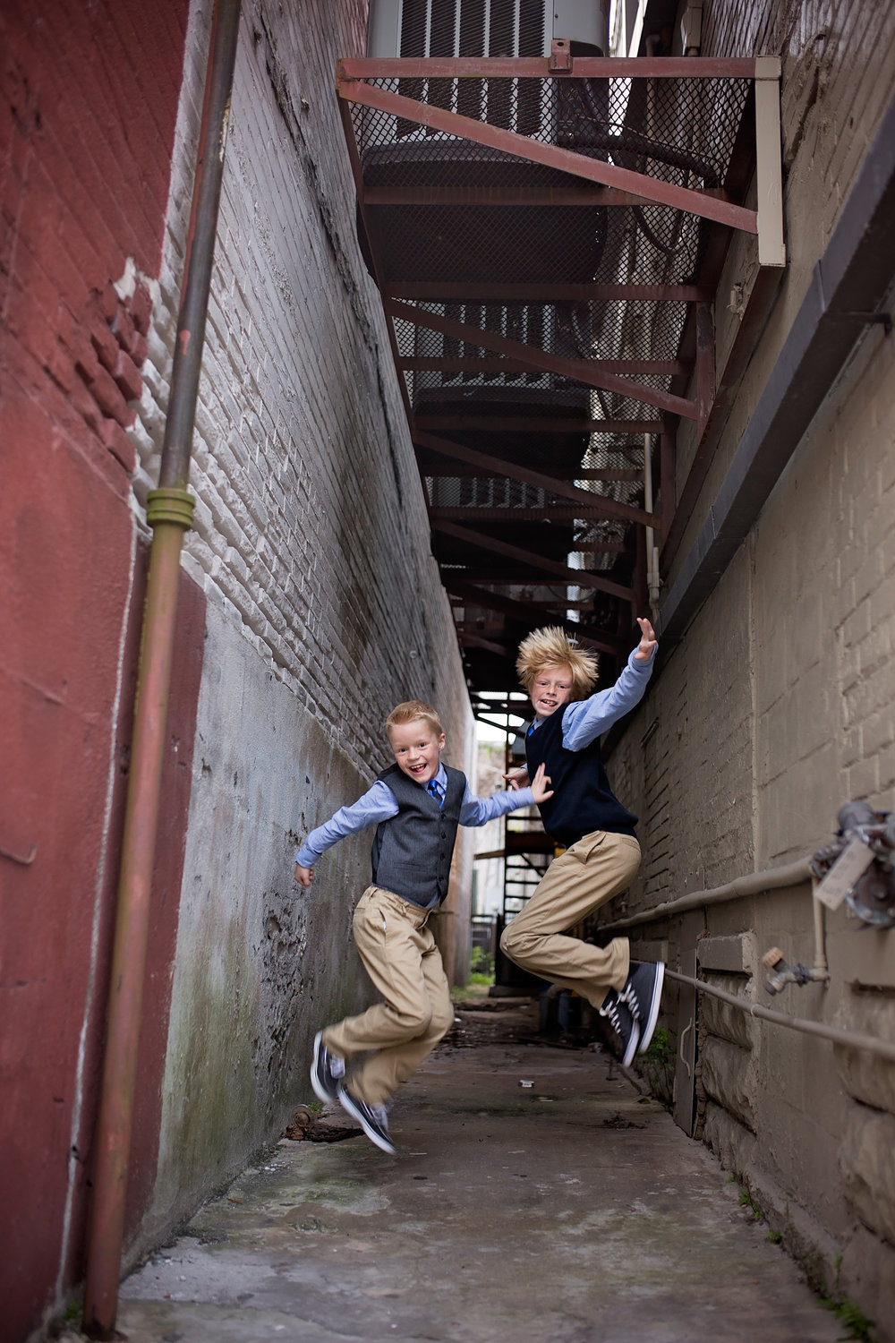 Brothers jumping for family pictures