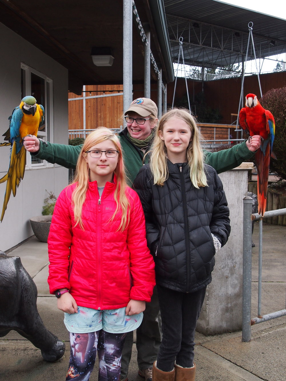 Harper and I with talking Macaws