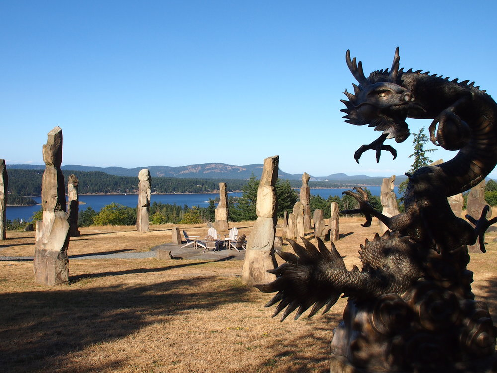 Mini-Stonehenge garden with adirondacks