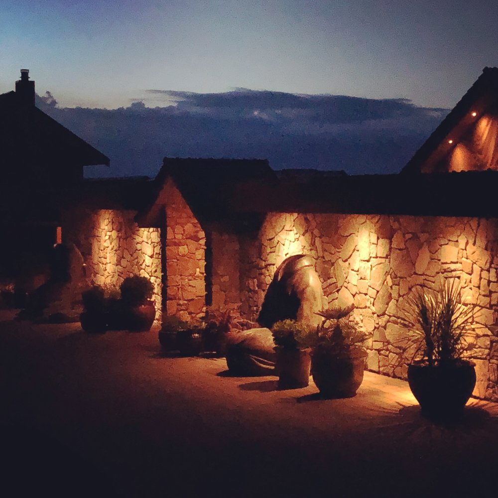 The beautifully-lit main house at night