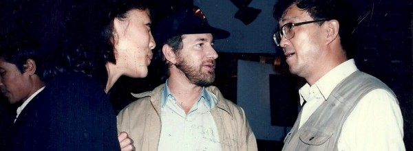 With-Steven-Spielberg-on-my-first-real-movie-EMPIRE-OF-THE-SUN-80s.-We-were-meeting-with-the-Spielberg-of-China-Xie-Jin.1-600x220.jpg