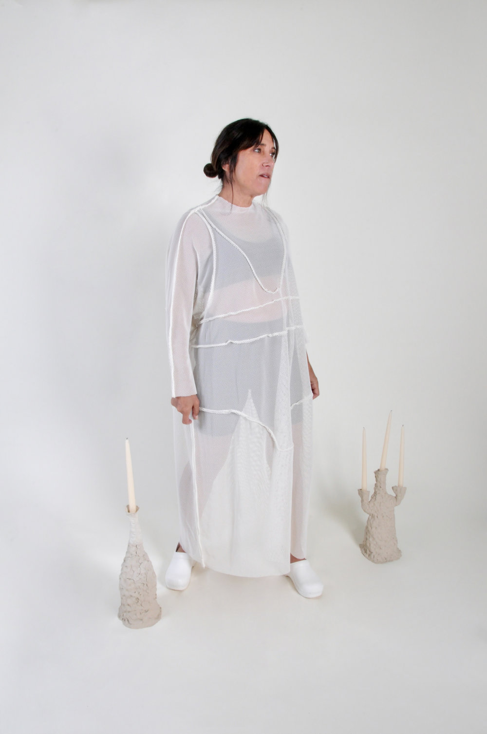 UNDERWEAR DRESS: IVORY NET - 0216COLOR : IVORYFABRIC : DEADSTOCK STRETCH NETCONTENT: COTTON / POLY / RAYON BLENDWHOLESALE $114 / RETAIL $228SIZES : ONE SIZE / FITS XS - XL