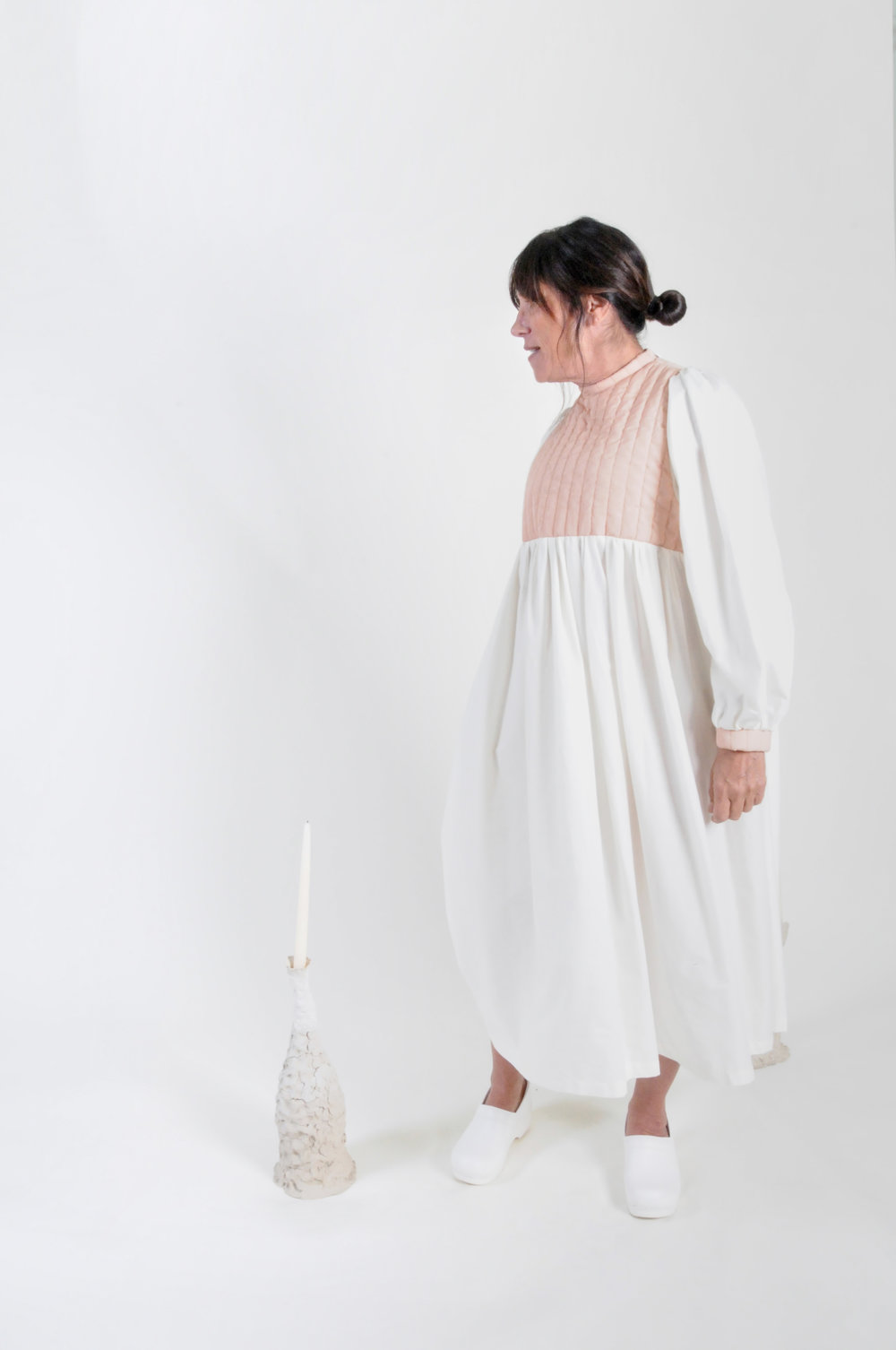 mom's quilted dress: blush and ivory - 0220COLOR : BLUSH AND IVORYFABRIC : DEADSTOCK QUILTED COTTON AND COTTON LAWNCONTENT: 100% COTTONWHOLESALE $124 / RETAIL $248SIZES : ONE SIZE / FITS XS - XL