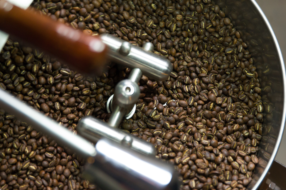 Freshly roasted beans cooling in the tray.