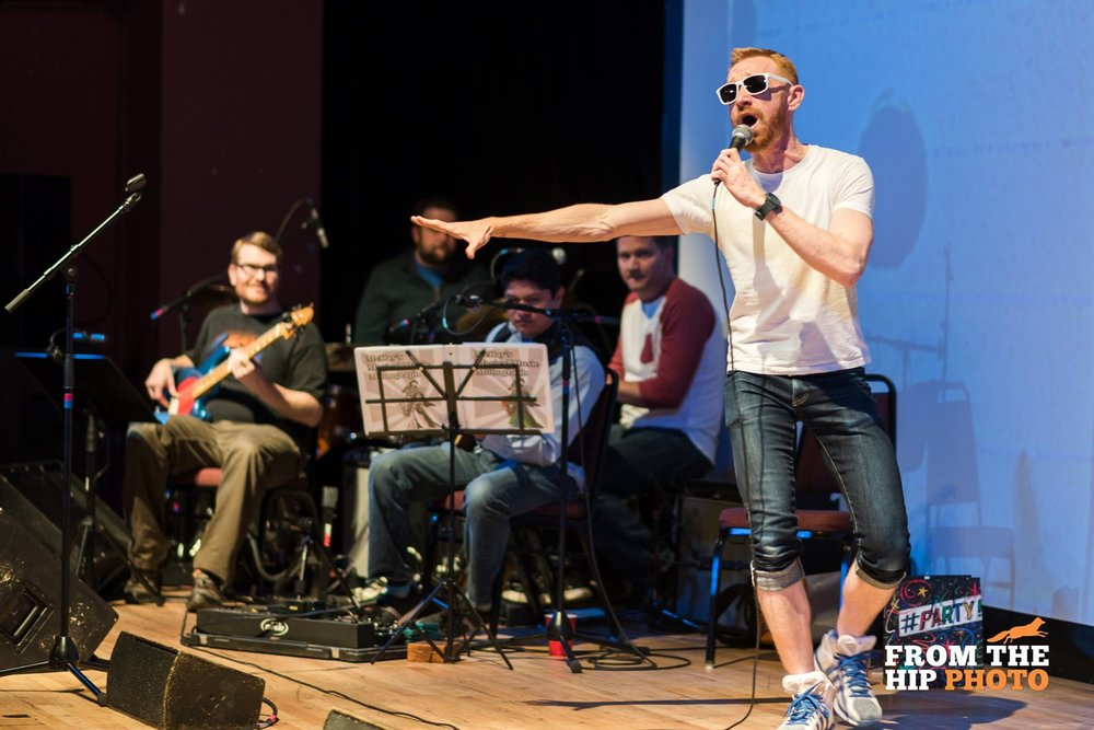 David performs onstage in between readers during a Mortified show with house band Hot Lunch. Photo by  From The Hip Photo