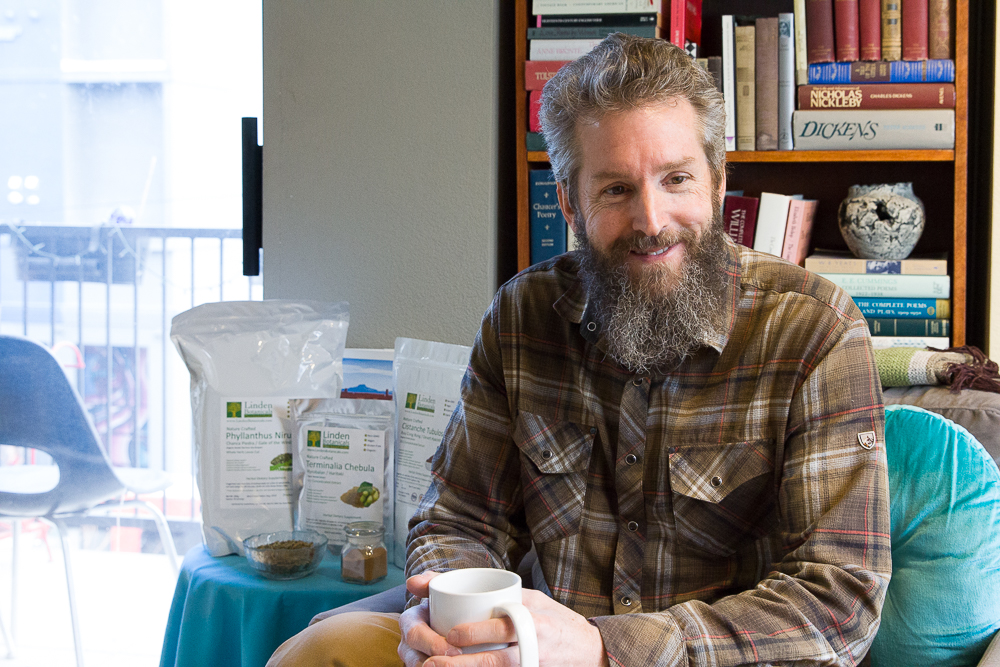 Michael Van der Linden at home in Denver with coffee, books, and teas.