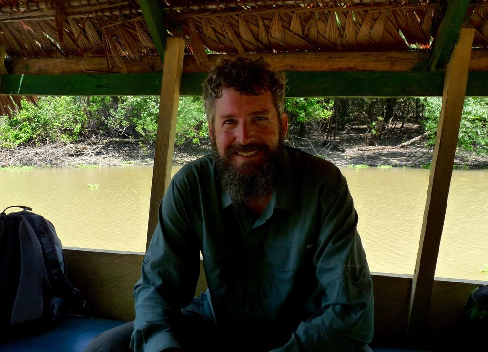 Michael on a boat on the Amazon in search of Phyllanthus Niruri (2017).