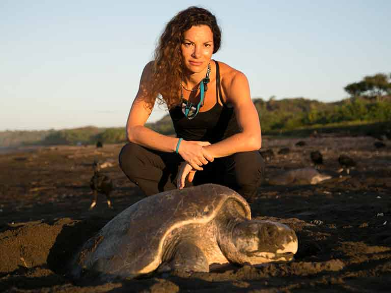 Gaia Vince meets a tortoise in Channel 4's Escape to Costa Rice. Picture: Channel 4.