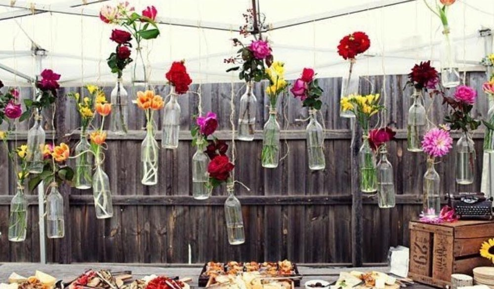 @upcyclethat  turns empty glass bottles into beautiful hanging vases for holiday tables. Picture: MakeSmthngWeek.
