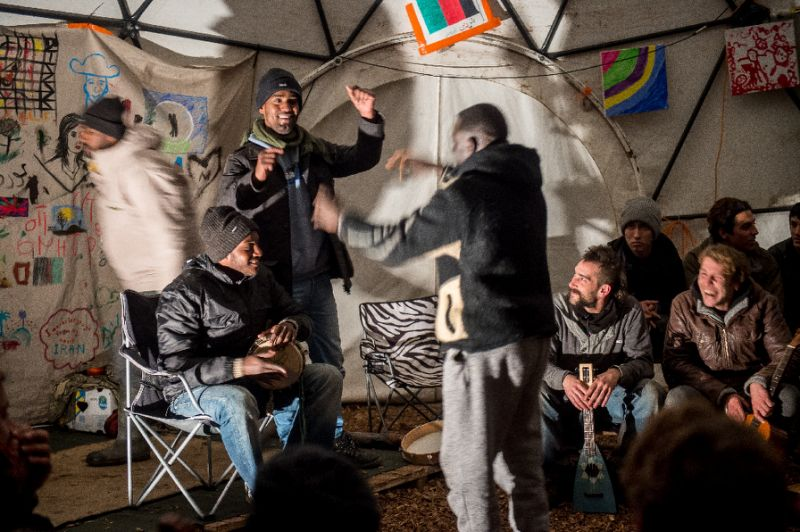 Music in the Good Chance theatre dome in the Calais Jungle. AFP Photo/Philippe Huguen via  www.yahoo.com