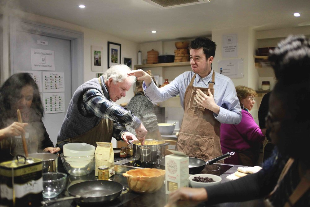 Participants from Deaf Plus, a charity that supports people with hearing issues, get stuck in at a Made In Hackney cookery class. Photography:Danielle Morainna.