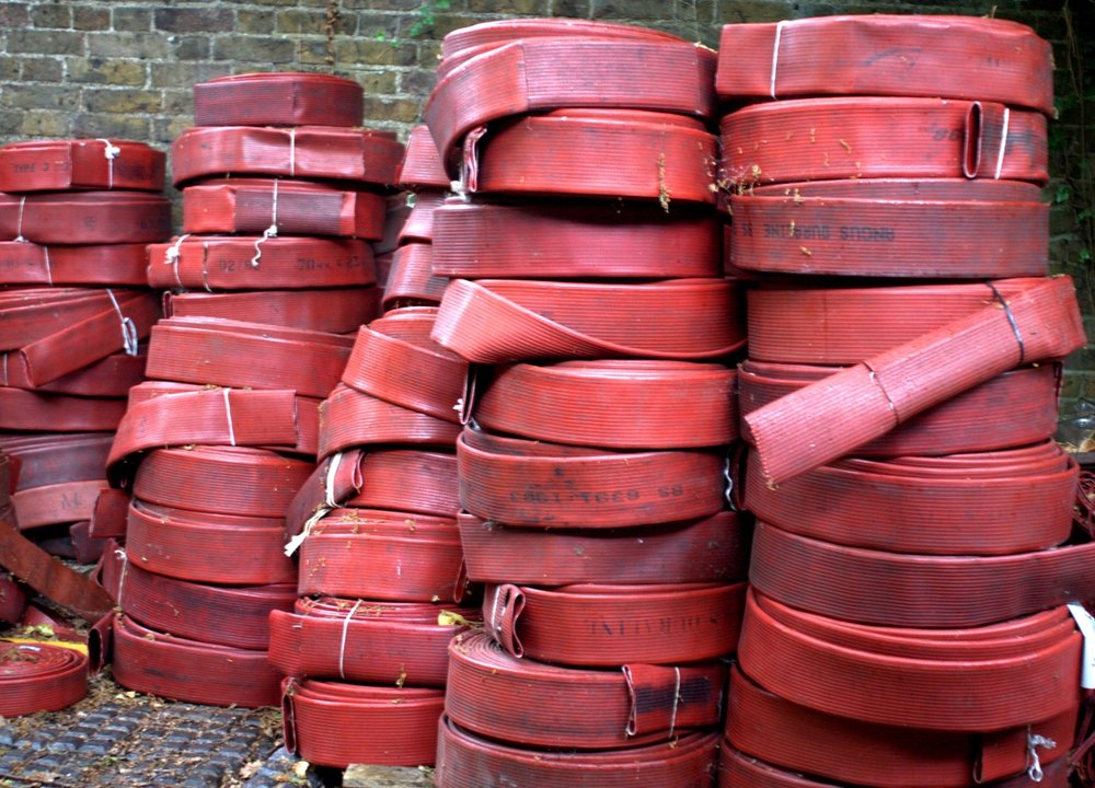 - 'All coiled up in these big red rolls, ready to go to landfill': decomissioned firehoses in their original state. Picture: Elvis & Kresse.