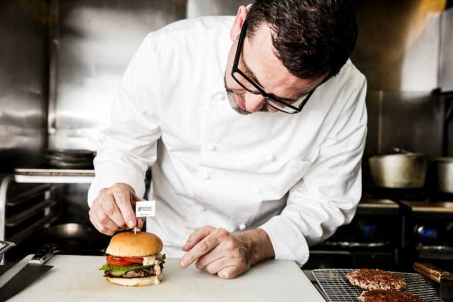 Renowned vegan chef Tal Ronnen pins a flag in one of Impossible Foods' cruelty-free burgers, which have just been added to the menu of his restaurant, Crossroads, in Los Angeles.  https://inhabitat.com