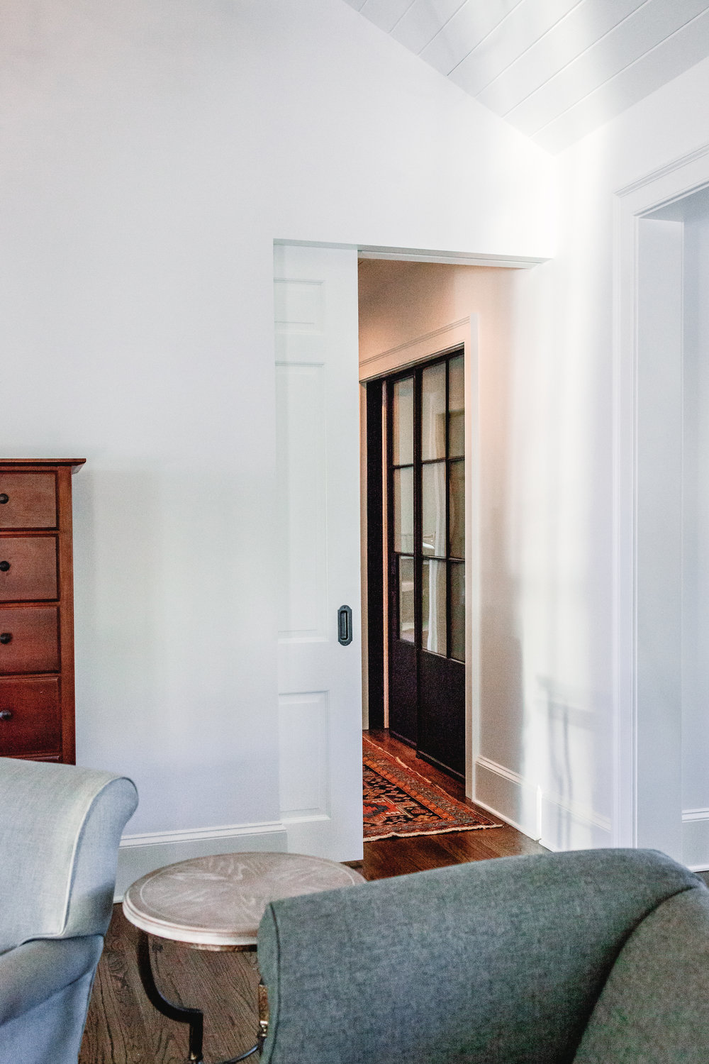 A discrete pocket door provides separation when needed between the bedroom and closet/bathroom areas.