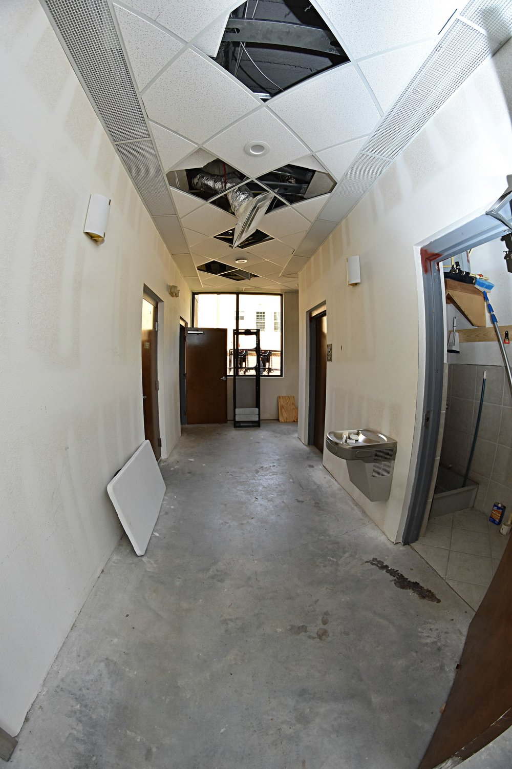 1st Floor Lobby   Restroom hallway with view all the way to the back of the building.