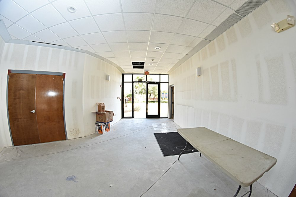 1st Floor Lobby   Entrance of the USSI HQ, with cafe and training room doors on the left, stairwell on the right.