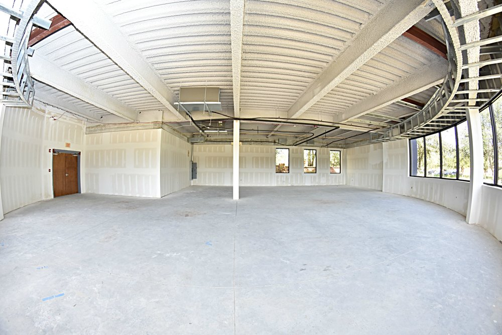 1st Floor Client Retreat   The right side of our building will house a large cafe, training room, and concierge office. The rounded windowed area you see, will be the cafe.