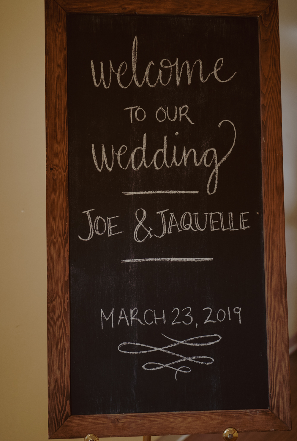 Our venue had a sweet girl who does chalkboard art decorate this welcome board when people entered the lodge.