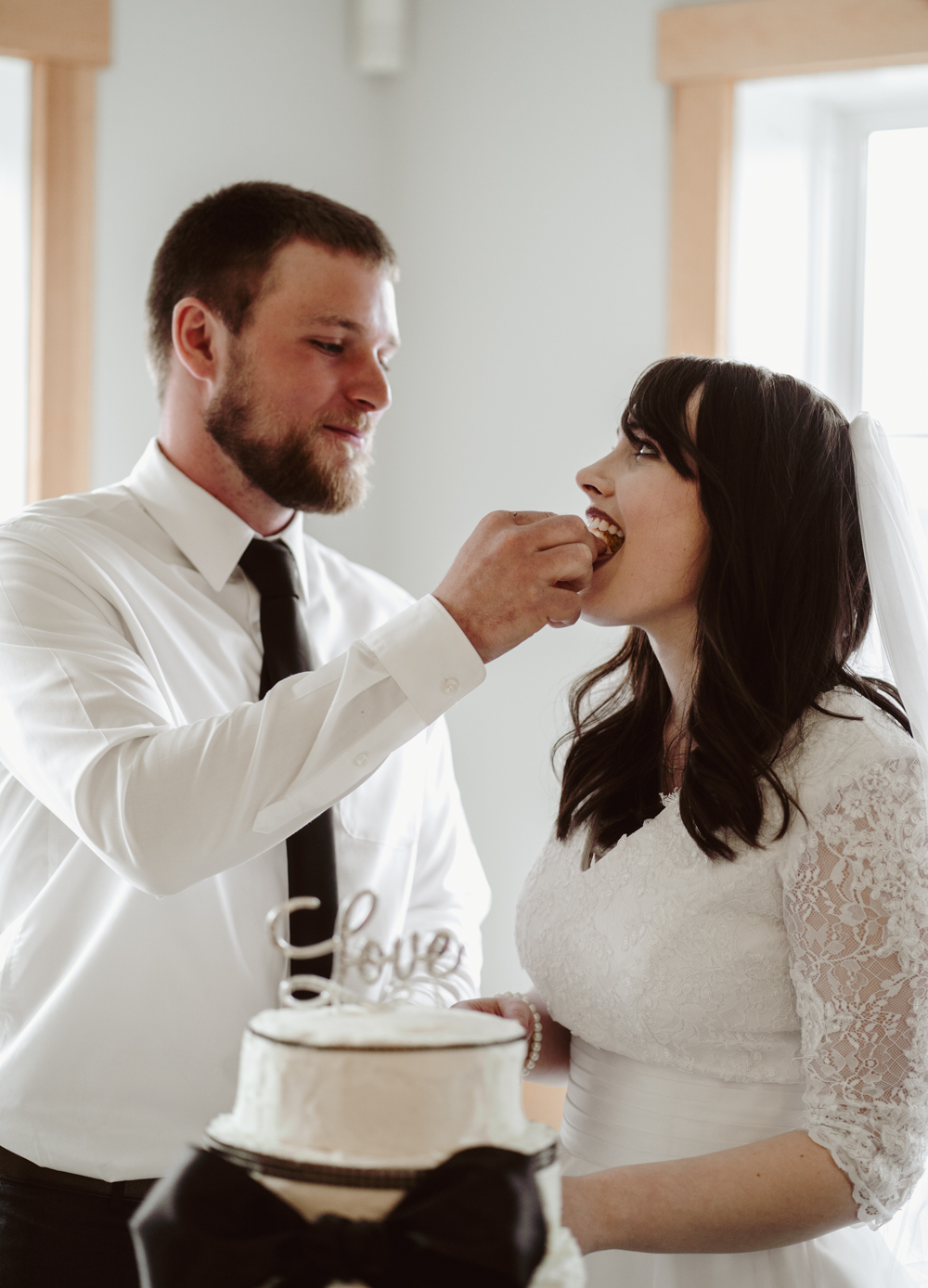 One thing Joe and I both felt strongly about was that he was not going to smash cake into my face. That face went through a lot to look decent on our wedding day. ;) So in this picture he's gently putting cake into my mouth. He's nice. I'm glad I married him.