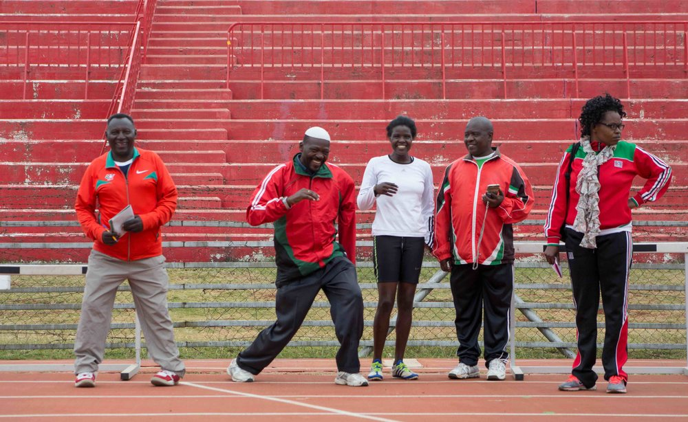 Kenyan National Paralympic Coaches enjoying the start of practice. (Male Coaches from Left to Right Coach Stephen, Michael Omondi, John Kariuki) – Photo by Wes Parnell
