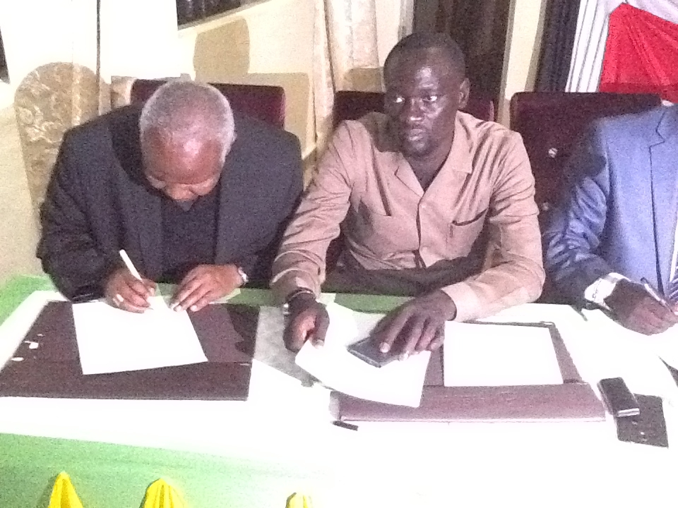 Bishop Korir and leaders from the warring communities signing a peace pact