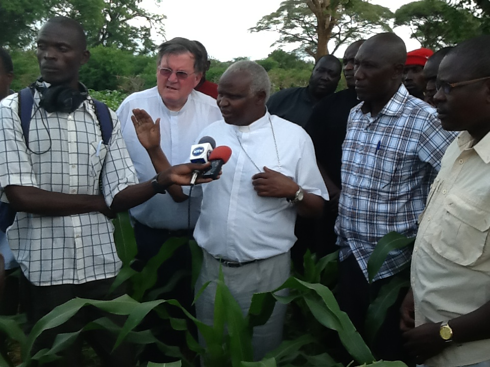 Bishop Korir and Bishop Maurice Crawley with experts and residents of Kainuk at the agriculture peace connector project in Kainuk