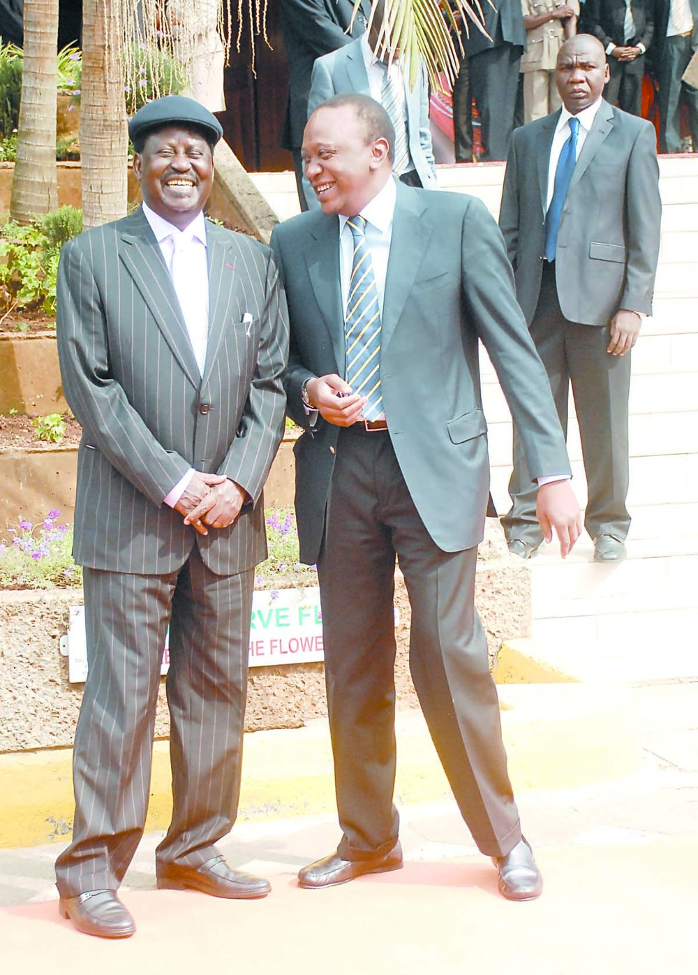 President Kenyatta (r) shares a light moment with opposition chief Raila Odinga (r). Despite their public spats, the two are long time family friends who visit and talk to each other on a regular basis, as confirmed by Odinga in a recent TV interview