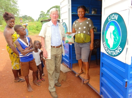 Lion Mountains board member Peter Penfold, former British High Commissioner, at one of thirty kiosks the company erected to market local rice for the poor. Photo: Jenny James Taylor