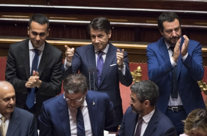 Italy's new prime minister Giuseppe Conte (center), flanked by Luigi Di Maio (left) and Matteo Salvini (right), at a recent parliament meeting. (Photo courtesy of the Italian Prime Minister's Office)