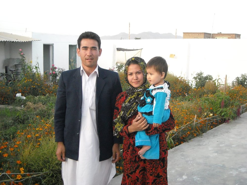 Aziza with her late husband Hassan and daughter.
