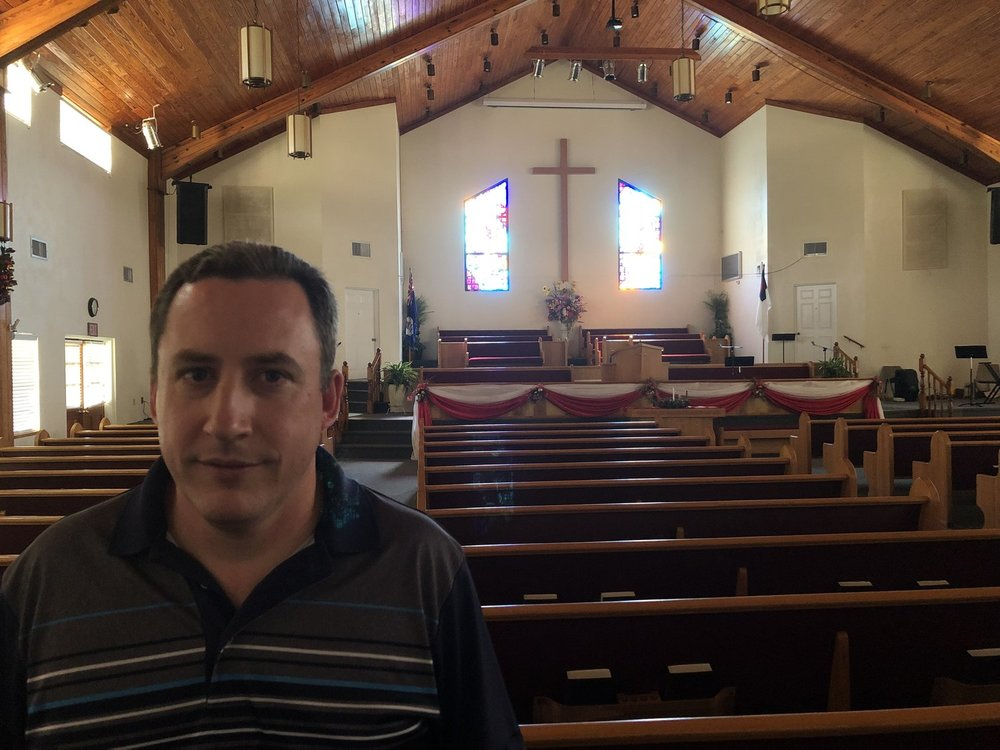 Pastor David Woods inside the Red Bay Church of God (Holiness), which plans the annual caroling road show around Grand Cayman Island.
