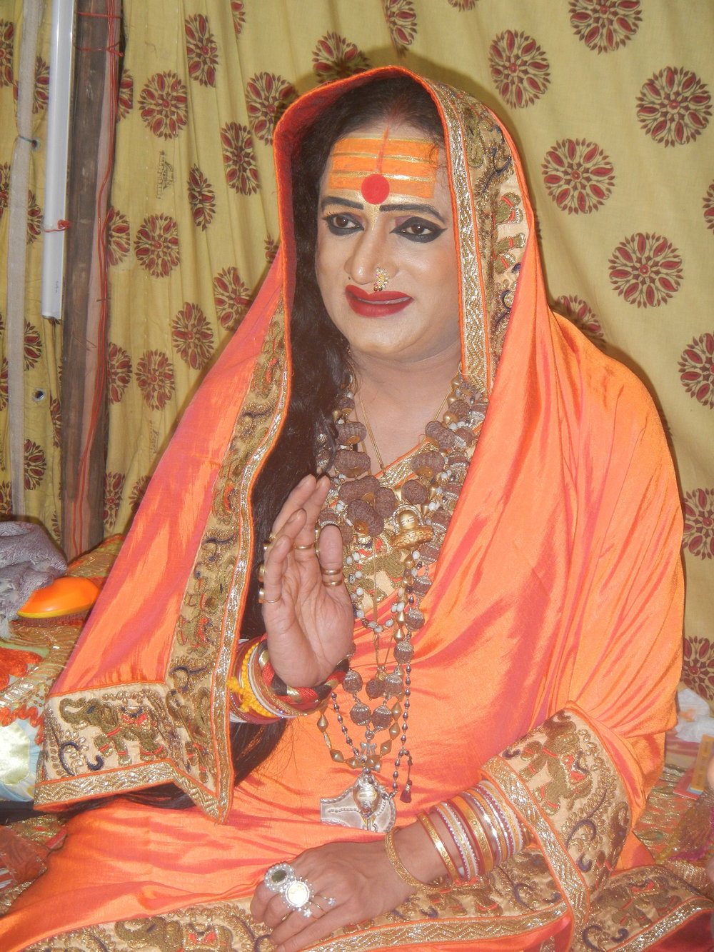 Laxmi Narayan Tripathi, the chief spiritual guardian of Kinnar Akhara, at a social congregation in Prayagraj, India. Photo by Priyadarshini Sen.