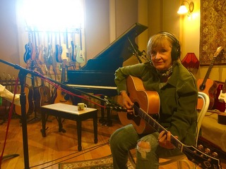 Pam Mark Hall singing in her studio.
