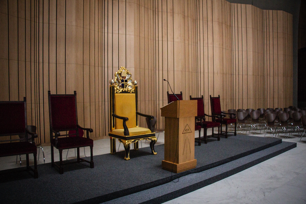 The chair where Pope John Paul II once sat on stands in the center of the altar. The lectern in front bares the eye of providence.