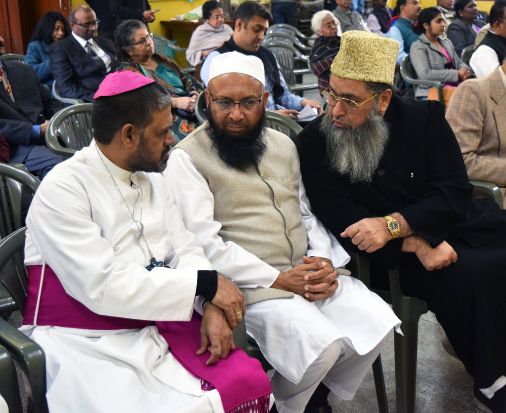Catholic Bishop Theodore Mascarenhas (left) speaks with Dr. Umer Ahmed Ilyasi, an imam and president of the Imam Council of India (right) at an interfaith conference Feb. 23, 2019 in Delhi.